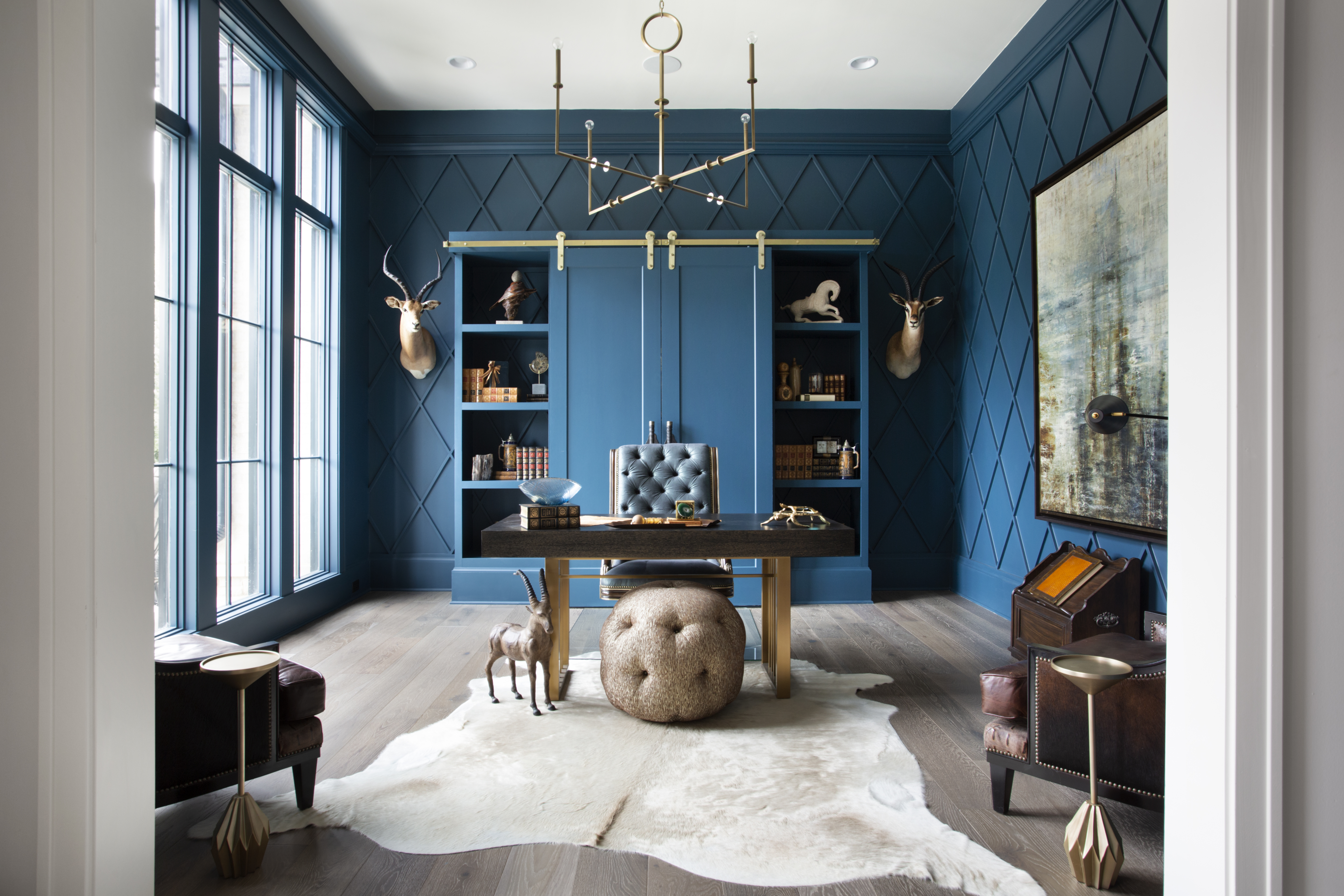 "Luxe home office featuring 7"" wide plan european oak flooring and bold blue walls and trim"
