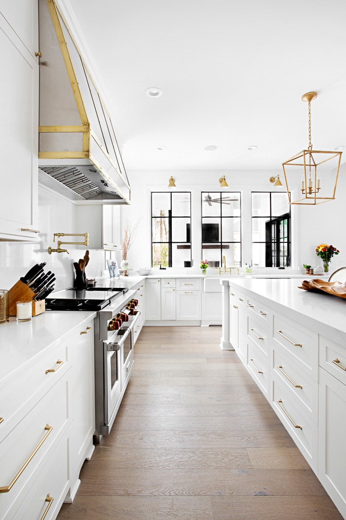"Transitional bohemian kitchen featuring 7"" wide plank custom hardwoods by Textures Nashville"